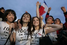 Sarkozy supporters celebrate on the Champs-Elysees in Paris [Reuters]