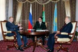 Putin, left, seals the  deal with Berdymukhamedov and Nazarbayev in Turkmenbashi on Saturday [AFP]