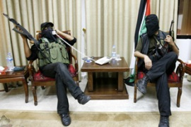 Hamas fighters posed for photographs after capturing the presidential compound in Gaza City [Reuters]