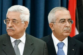 Abbas, left, with Salam Fayyad, who is sworn in as prime minister [Reuters]