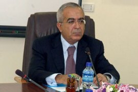 Fayyad held his first cabinet meeting in Ramallah saying security was his government's priority [AFP]