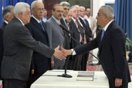 Abbas swore in the new cabinet after dismissing the Hamas-led Palestinian unity government [AFP]