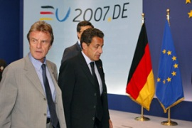 Sarkozy, right, met the German chancellor to urge negotiation with Poland [Reuters]