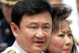 Thaksin and his wife Pojaman, right, have been charged over a controversial land purchase [AFP]