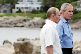 Putin, left, offered Bush a new missile plan earlier this week [AFP]