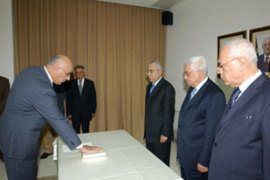Abbas, second right, appointed three new ministers to the caretaker government [AFP]