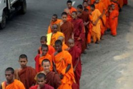 In Colombo, Buddhist monks paraded through the streets offering blessings to government forces [EPA]