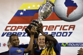 Brazil's Gilberto Silva, left, and Juan hoist the trophy in Maracaibo on Sunday [Reuters]
