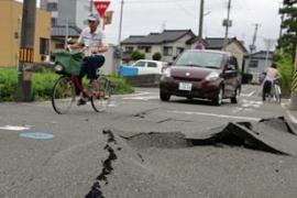 The force of the quake opened up cracks a metre wide in the earth along the coastline [AFP]