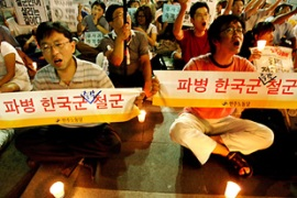 South Korean anti-war protesters have demanded the country withdraw troops from Afghanistan [EPA]