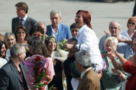 Family and friends ran to welcome the six on the tarmac at Sofia airport [AFP]