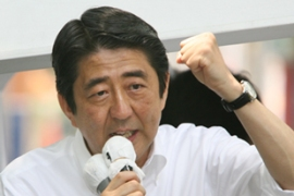 Abe said there will be a cabinet revamp later [AFP]