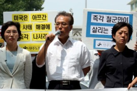 The opposition Democratic Labour party were outside the US embassy in Seoul to urge intervention [EPA]