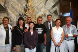 Five Bulgarian nurses and a Palestinian doctor were returned to Bulgaria after eight years in jail [AFP]