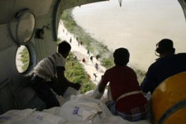 Food is dropped from a helicopter to villagersin Darbhanga district [AFP]