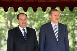 Al-Maliki, left, was caught off guard by Erdogan's request to sign the counter-terrorism pact [AFP]