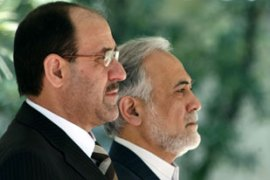 Al-Maliki, left, attended a welcoming ceremony with Parviz Davoudi, the Iranian vice president [AFP]