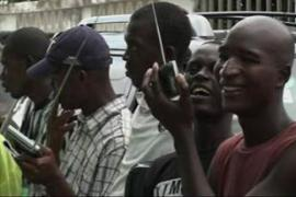 People in Freetown eagerly listen to the first round of election results