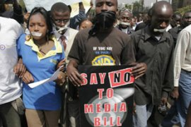 Kenyans taped shut their mouths in Nairobi to condemn the proposed media law [AFP]