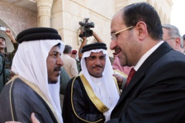 Al-Maliki, right, was in Tikrit on Friday canvassing the support of Sunni leaders [AFP]