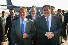 Hoshyar Zebari, right, Kouchner's Iraqi counterpart met the French minister at Baghdad airport [AFP]