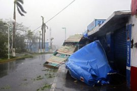 Streets were flooded, trees felled and roofs blown off houses when Dean made landfall [AFP]