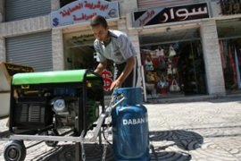 Gazans have been forced to use generators throughout the week [AFP]