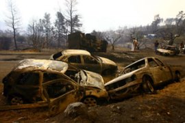 Cars, houses and fields were burnt as fires sweptthe Peloponnese region [AFP]