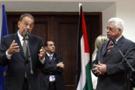 Abbas, right, announced the change after meeting Solana, EU's foreign policy chief, in Ramallah [AFP]
