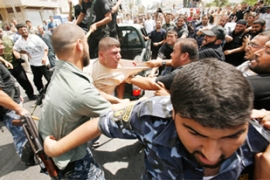 The Executive Force dispersed Fatah activists using stun grenades and firing bullets in the air [Reuters]