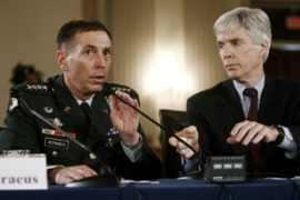 Petraeus, left, and Crocker said progress had been made militarily in Iraq [Reuters]