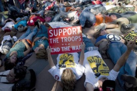 "Anti-war protesters carried out a ""die-in"" rally in front of the US Capitol building [AFP]"