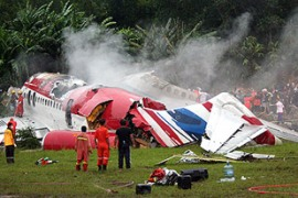 The jet carrying 130 people skipped and skidded off the runway while trying to land, survivors said [AFP]