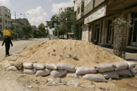 Sand barriers have been built on some Gaza streets in anticipation of Israeli raids [Reuters]