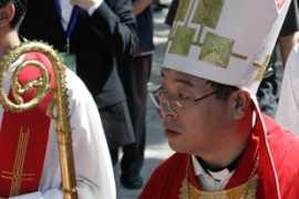 "Li took an oath of service to the church and vowed to maintain ""national unification"" [Reuters]"