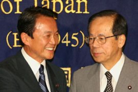 Fukuda, right, defeated Taro Aso in the race tosucceed Shinzo Abe as LDP leader [AFP]