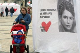 The poster from Tymoshenko's campaign reads 'Justice, it is worth fighting for' [AFP]