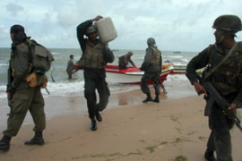 Sri Lankan security forces ferry supplies in to the newly recaptured coastal area [EPA]