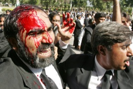 Police clashed with anti-Musharraf protesters on Saturday [AFP]