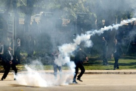 Lawyers hurled tear gas canisters fired by police [AFP]