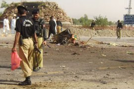 The bomb was detonated at a police checkpoint in the garrison town of Bannu [AFP]