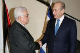Israel says there was a plot to attack Olmert, right,  while he visited the West Bank [AFP]