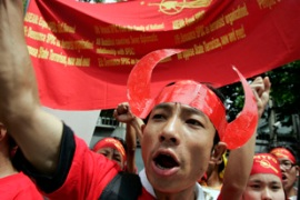 Protests continue in Asia as Malaysia urges Myanmar to talk to Aung San Suu Kyi [REUTERS]