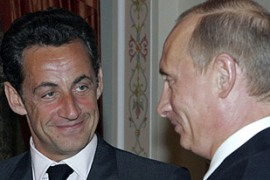 Sarkozy, left, was optimistic about reaching a compromise with Putin on Iran and Kosovo [Reuters]