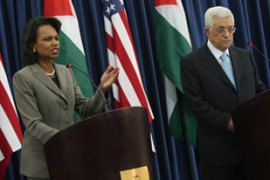 Rice, left, told Abbas that Washington was committed to a two-state solution for the region [AFP]