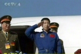 Yang is China's first astronaut, flying 18 times around the Earth aboard Shenzhou V spacecraft in 2003 [AP]
