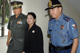 "President Arroyo, centre, has ordered police to leave ""no stone unturned"" in the investigation [AFP]"