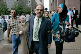Shukri Abu Baker, centre, faces a new trial at aTexas courthouse [Reuters]