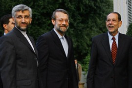 Jalili, left, and his predecessor Larijani, centre,  met Solana in Rome on Tuesday [AFP]