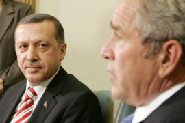 Bush told Erdogan, left, that the US is ready to share intelligence with Turkey on PKK [Reuters]